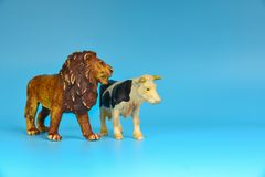 Toy animals made of plastic on a blue background, baby little animals.  royalty free stock photo