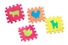 Toy animals mats with interlocking parts. Educational toy for children colorful foam mats collection on white background, sorter, interlocking pieces - domestic Royalty Free Stock Photos