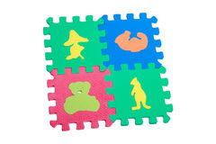 Toy animals mats with interlocking parts. Educational toy for children colorful foam mats collection on white background, sorter, interlocking pieces - animals Royalty Free Stock Photo