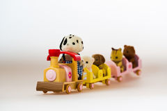 Toy animals sitting on toy train. Toy train with toy animals royalty free stock photography