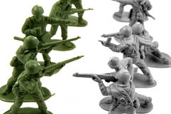 Toy army men standing at odds Stock Image