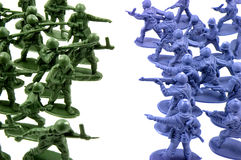 Toy army men standing opposite one another Royalty Free Stock Photos