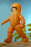 Toy astronaut. Plastic toy astronaut running around on the sand Royalty Free Stock Photography