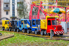 Toy attraction of the five machines for children in the fall on a rainy day. Not working attraction of the five toy cars in the fall on a rainy day Stock Images