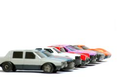 Toy auto stand in a row. Seven models of cars stand on start Stock Photo
