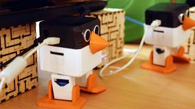 Toy automatic robots are dancing on the table stock images