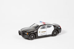 Toy 911 automobile. In white Royalty Free Stock Photos