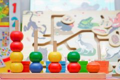 Pyramid build from colored wooden rings. Toy for babies and toddlers to joyfully learn mechanical skills and colors and numbers. b royalty free stock image
