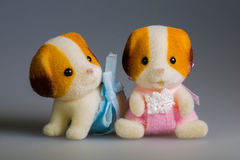 Toy baby dogs. Toy doggie, made from plush royalty free stock image