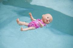 Toy baby doll floating Stock Photo
