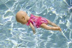 Toy baby doll floating Stock Photography