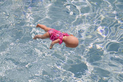 Toy baby doll floating Royalty Free Stock Images