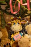 Toy Baby Giraffe. Sitting under a christmas tree Royalty Free Stock Image
