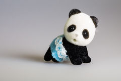 Toy baby panda. With skirt stock images