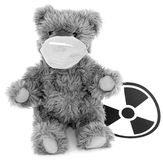 Toy baer and sign to radiation. Toy brown baer in respirator and sign to radiation Stock Image