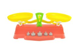 Toy balance with weights. Of colored plastic against white background Stock Photos