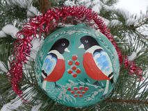 Toy ball with a birdie. On the tree Stock Image