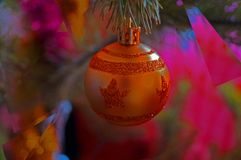Toy ball on a fir tree branch. Toy ball on a fir branch abstraction splinters colored glass Royalty Free Stock Image