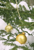 Toy ball and snowman over fir tree. Stock Images