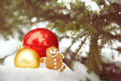 Toy ball and snowman over fir tree. Royalty Free Stock Image