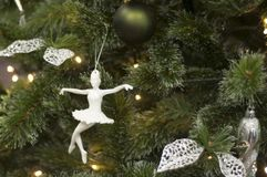 Toy ballerina on Christmas tree. New year decoration royalty free stock photography