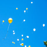 Toy balloons rise in the blue sky Royalty Free Stock Images