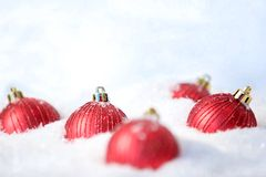 Toy balls in snow Stock Photos