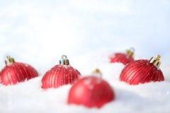 Toy balls in snow Stock Photos