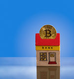 Toy bank building with bitcoin assets Royalty Free Stock Image