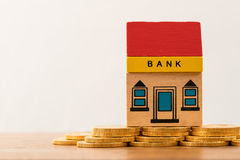 Toy bank building on gold coin assets Royalty Free Stock Image