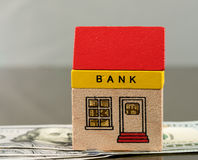 Toy bank building on US dollar assets Stock Photo