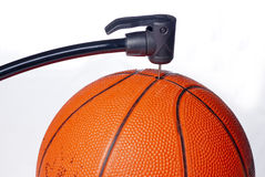 Toy Basket Ball gets some air from a pump Stock Photo