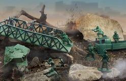 Toy battle. Green plastic warriors Royalty Free Stock Photo