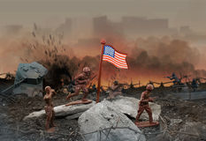 Toy battle. Plastic brown toy soldiers attack scene with American flag Stock Photos
