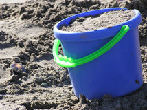 Toy Beach Bucket full of Sand Stock Images
