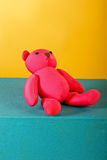 Toy bear. Glorious rose bear on a blue cube in a studio royalty free stock image