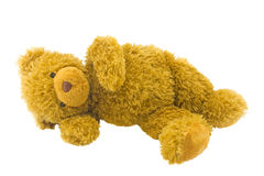 Toy bear. Children toy lies isolated on a white background Royalty Free Stock Photography