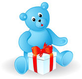 Toy bear. With a gift. A vector illustration Royalty Free Stock Photo