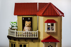 A toy bear on balcony. A toy bear standing on the balcony of a toy house royalty free stock images