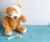 Toy bear with a bandaged head rewound. The basis for the banner associated with the health of children. Children health. Syringe stock photo