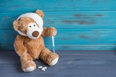 Toy bear with a bandaged head rewound. The basis for the banner associated with the health of children. Children health royalty free stock photos