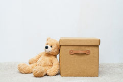 Toy bear and brown textile box with handles and cover Royalty Free Stock Images