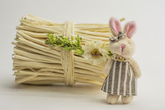 Toy bear and bunny sitting next to a bundle of brushwood Royalty Free Stock Image