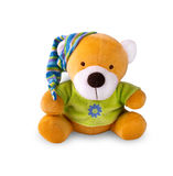 Toy bear in the cap on white background. Stock Photography