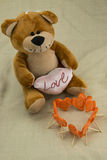 The toy bear, and carrots carved heart,. This is the theme of love Stock Images