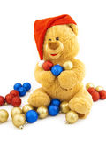 Toy bear in a Christmas cap Stock Image