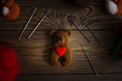 Toy bear with heart from wool for dry felting royalty free stock photo