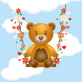 Toy bear cub on a swing Royalty Free Stock Images