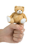 Toy bear and fist. Isolated on white background Stock Photo