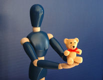 Toy Bear Gift. A toy bear is offered as a gift Stock Photos